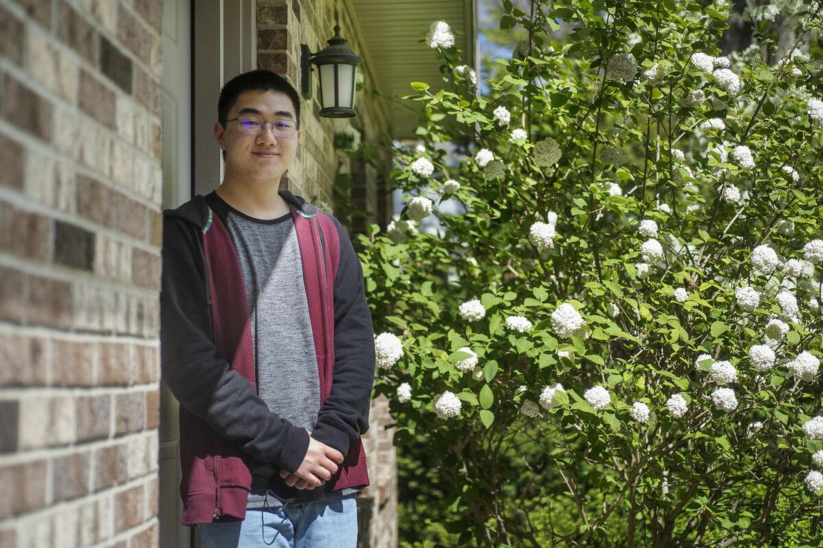 Andy Yao, an H. H. Dow High School student who recently won the senior paper division of the Michigan History Day contest, poses for a portrait Wednesday, May 12, 2021 at his home in Midland. (Katy Kildee/kkildee@mdn.net)