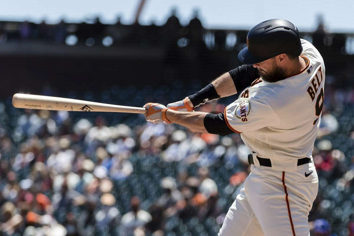 San Francisco Giants' Brandon Belt hits an RBI single against the Texas Rangers during the first inning of a baseball game in San Francisco, Tuesday, May 11, 2021. (AP Photo/John Hefti)