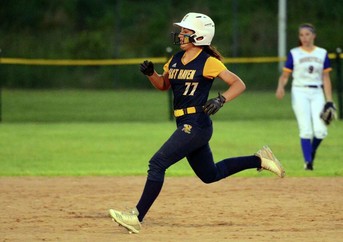 East Haven's Emilee Bishop (77) reaches second after hitting a double during Class L softball action against Brookfield in Stratford, Conn., on Tuesday June 4, 2019.