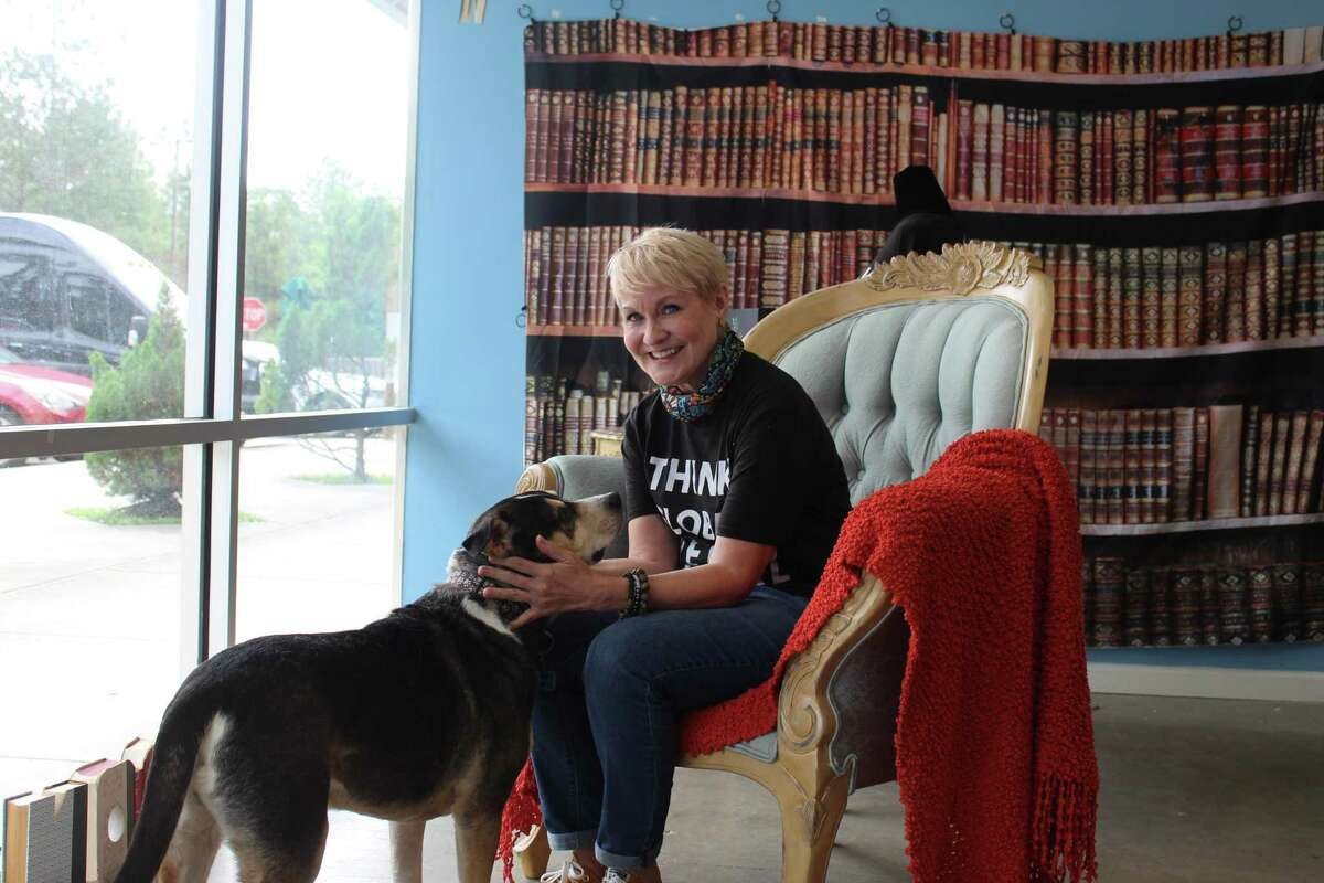 New Woodlands bookstore owner Teresa Kenney poses with her dog Oso inside the space that will become Village Books in the western area of The Woodlands in Sterling Ridge. The 1,500-square foot space is located in a mini-shopping center on the south side lanes of The Woodlands Parkway near the intersection of FM 2978 at 9955 Woodlands Parkway, Suite F.