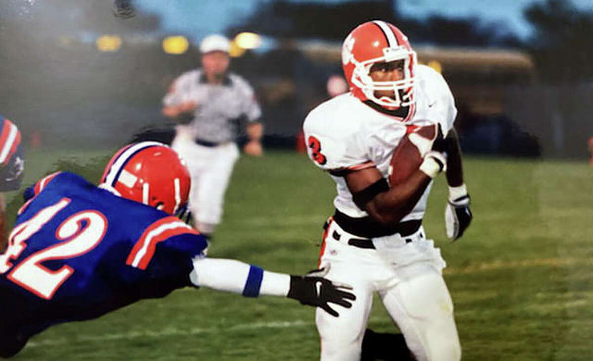 Milan Woodard eludes a tackler during his playing days at Edwardsville. A 2003 EHS graduate, Woodard held the program record for career rushing yardage until Justin Johnson Jr. broke it this year.