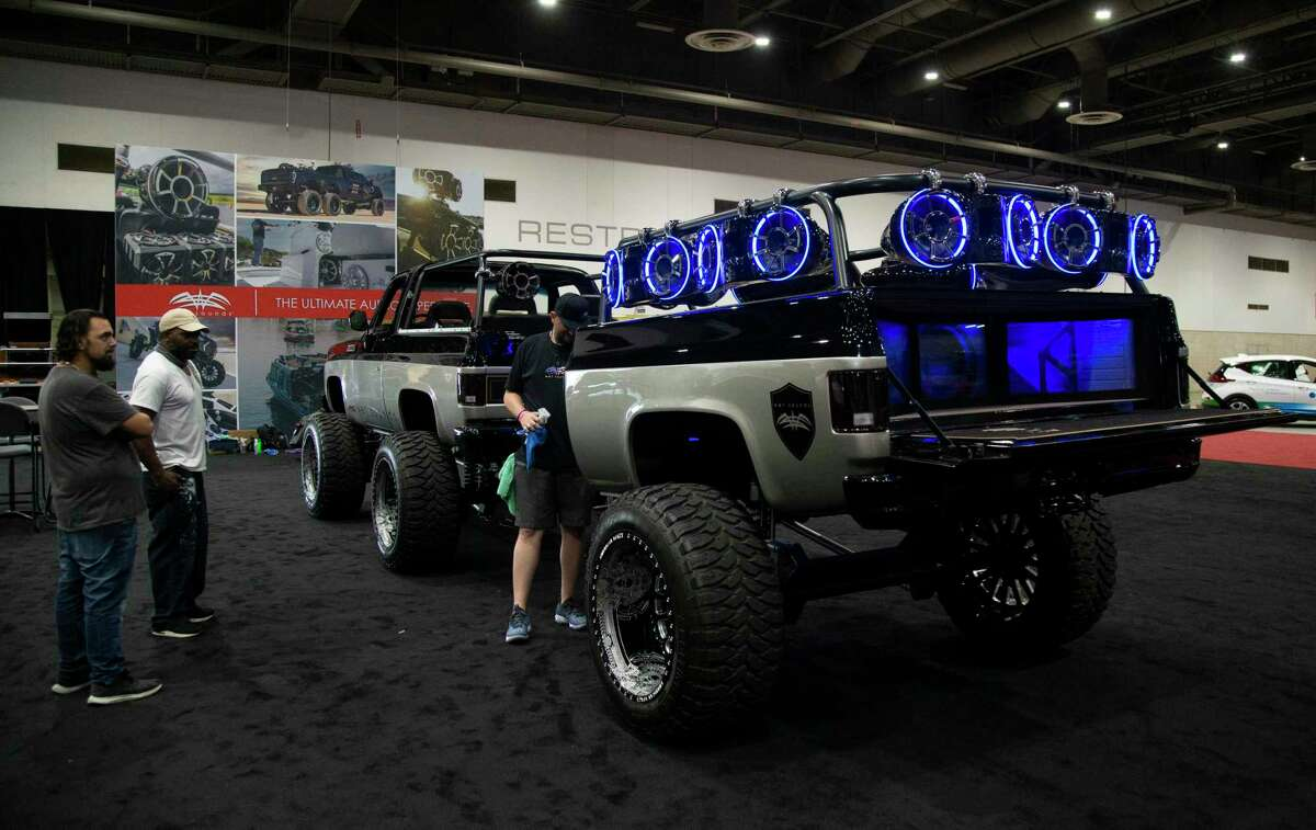People awing a customized Chevrolet K5 Blazer with an audio trailer by Wet Sounds is photographed at the Houston Auto Show Tuesday, May 18, 2021, at NRG Center in Houston. The show opens on Wednesday, May 19 to Sunday, May 23.