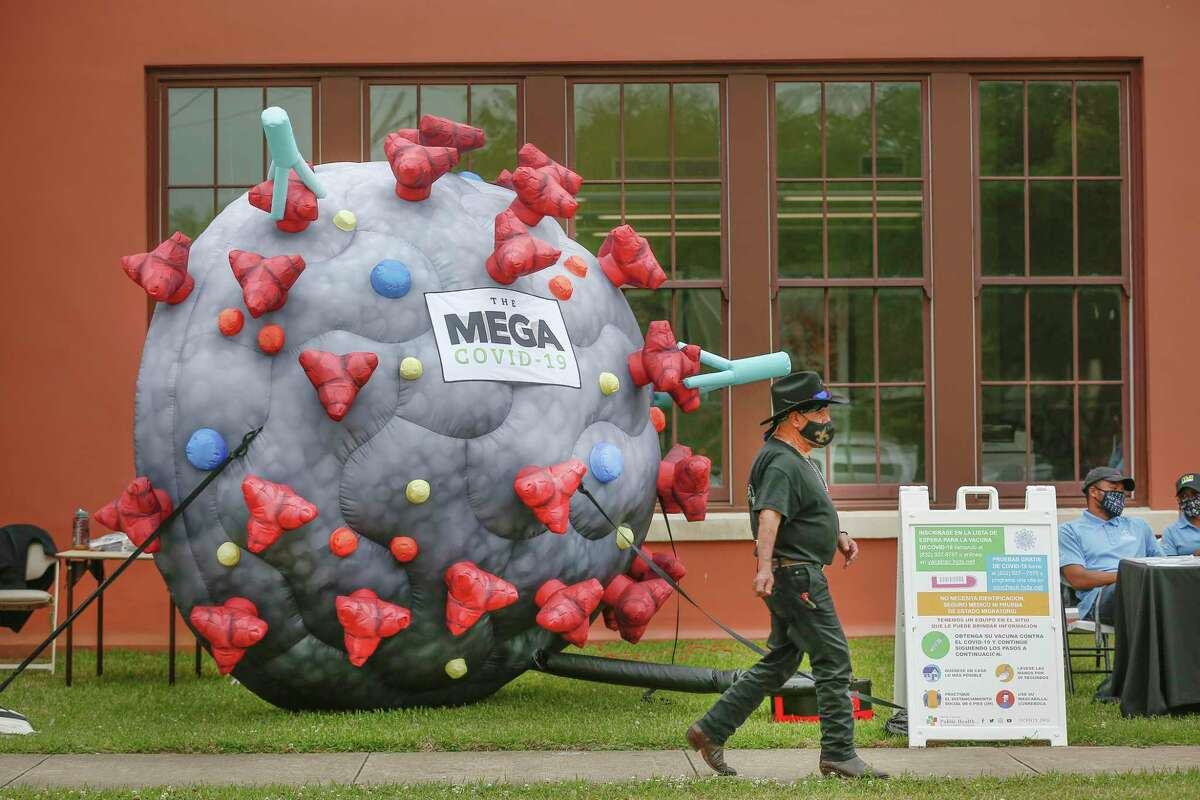 A large COVID-19 inflatable encouraged people to attend a Precinct 2 vaccine event at Leonel Castillo Community Center Tuesday, April 27, 2021, in Houston.