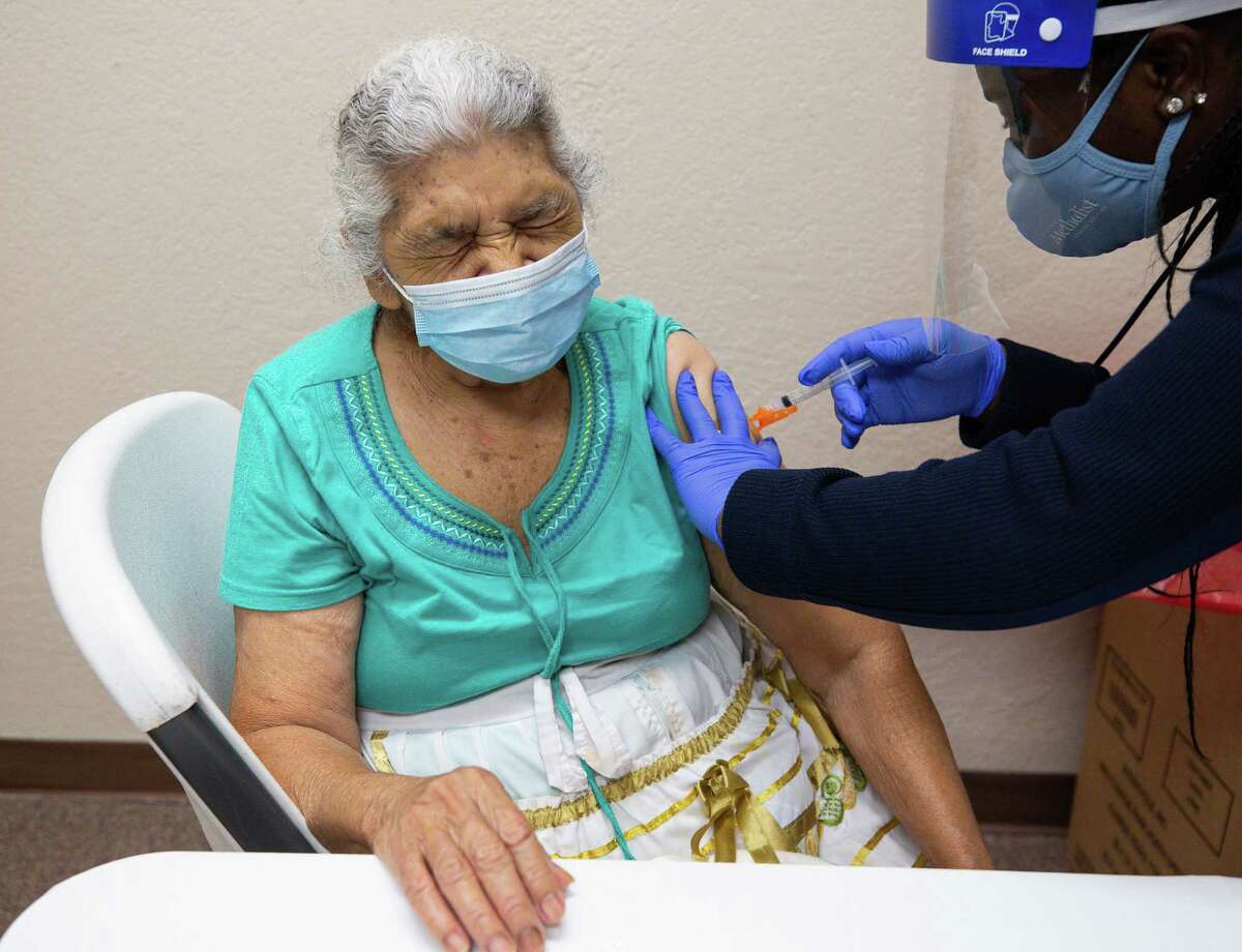 Gilma Saravia, 83, gets the Moderna COVID-19 vaccine at the Consulado General de El Salvador on Thursday, May 6, 2021, in Houston. Saravia said she waited so long to get the vaccine because her daughter - who she lives with - doesn't have a car and this is the closest a vaccination site has been to them. She said a friend called her daughter at 8 a.m. to tell them about the vaccination site.