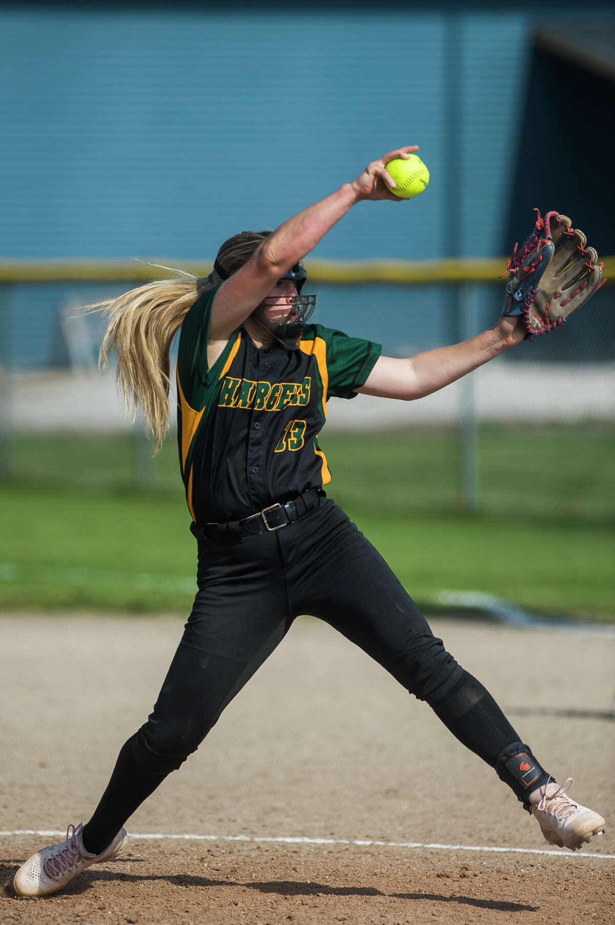 Dow's Delaney Belding pitches the ball during the Chargers' game against Midland Tuesday, May 18, 2021 at Midland High School. (Katy Kildee/kkildee@mdn.net)