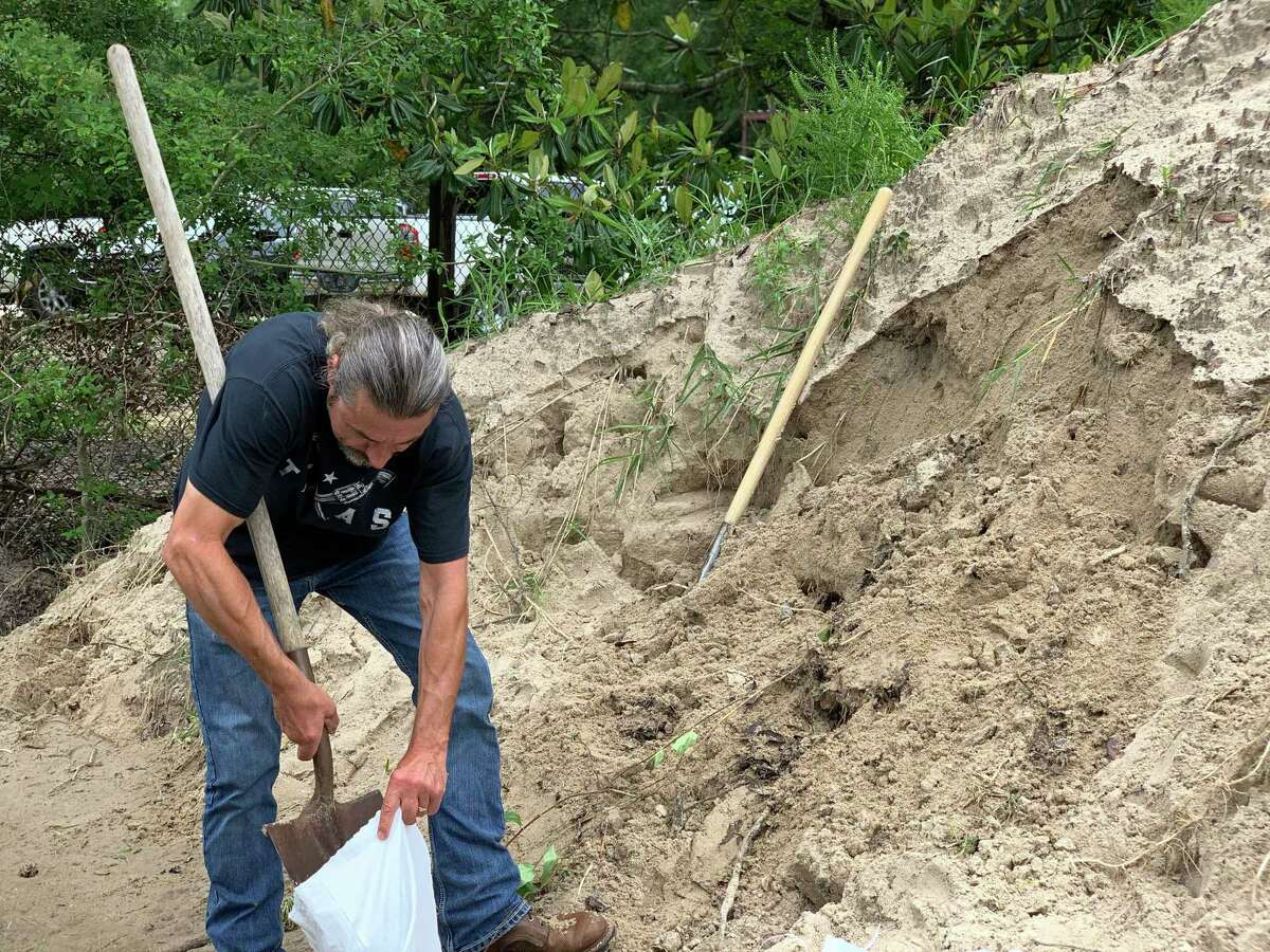 Jack Favors is one of many Hardin Co. residents preparing for the possibility of flooding by filling sand bags to protect homes and businesses. Torrential is rain in the forecast overnight and throughout the rest of the week.