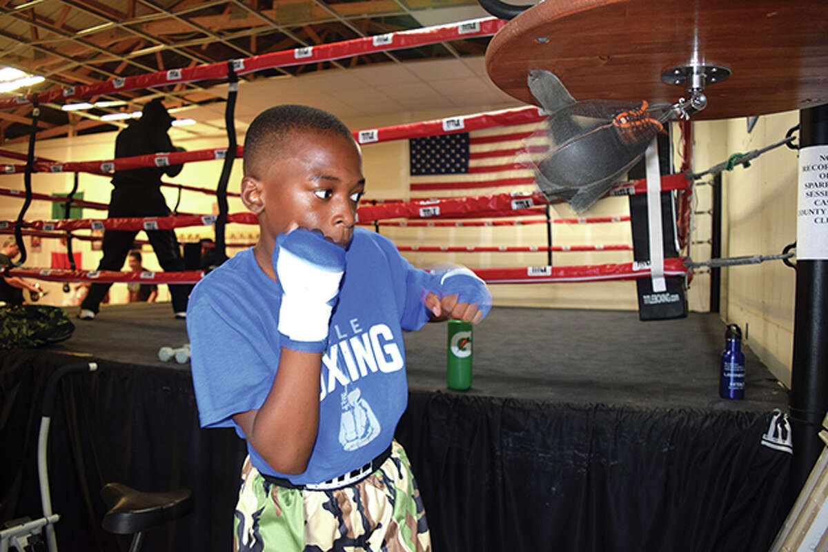 Mikyel McGowan, 10, of Jacksonville trains as a boxer at Cass County Boxing Club in Beardstown.