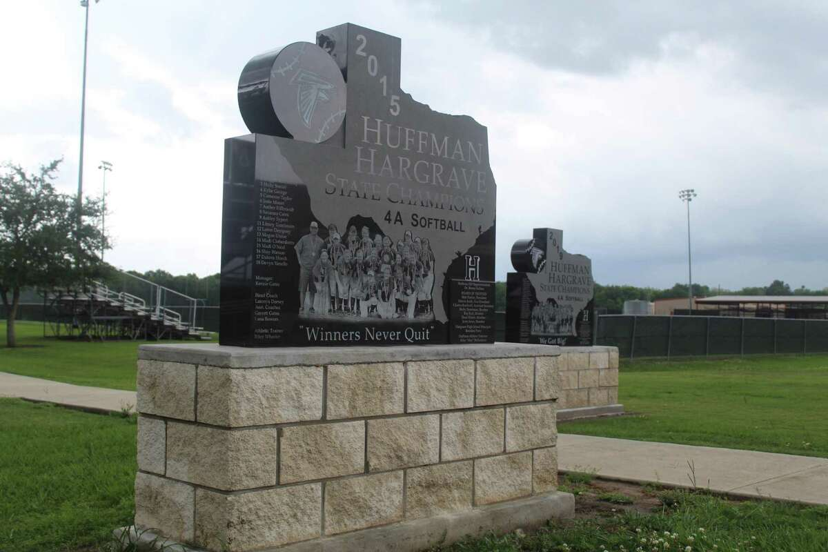 Two statues stand near the Lady Falcons Field showing Hargrave's state titles from 2015 and 2019.