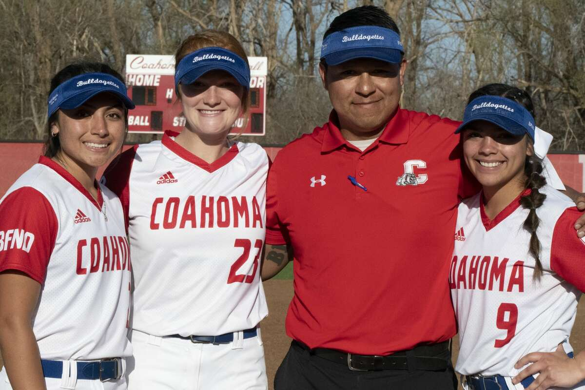Coahoma softball head coach Alex Orosco poses for a photo with his senior players during Senior Night on March 23, 2021. Also pictured are, from left, Jocelyn Torres-Mendoza, MaKynlee Overton, and Kenzi Canales.