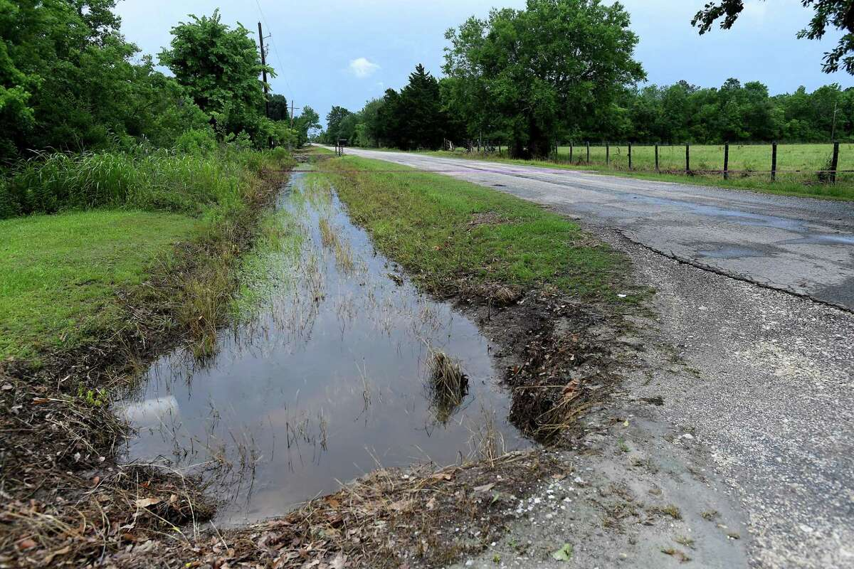 The drainage system into which the ditch behind Julie Meadows' home in Fannett should feed is well below flood stage, with little water movement evident Tuesday. Meadows' home and several properties on Boyt Road flooded after the area received over a foot of rainfall Monday. Photo made Tuesday, May 18, 2021 Kim Brent/The Enterprise