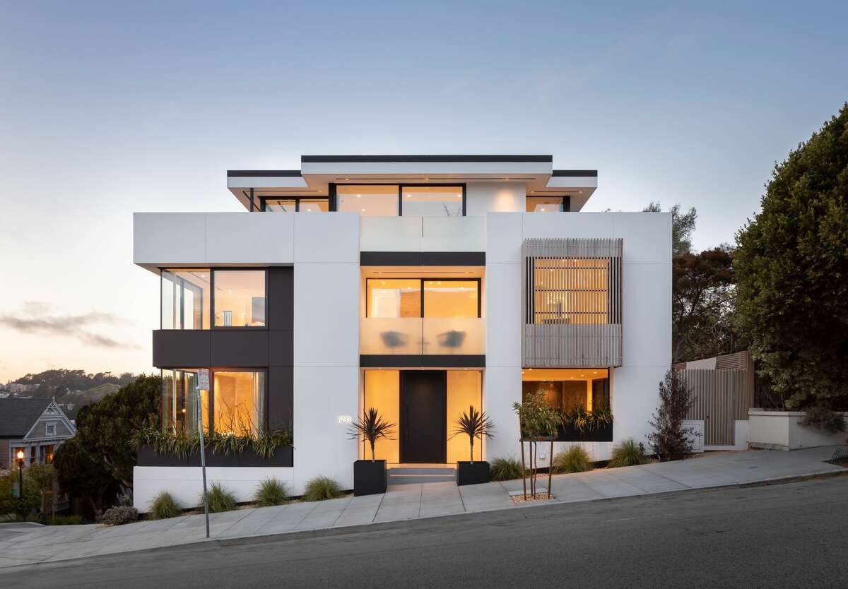 Seen from the street at dusk, the five-bedroom, 5.5 bathroom abode is a study in glowing angles.