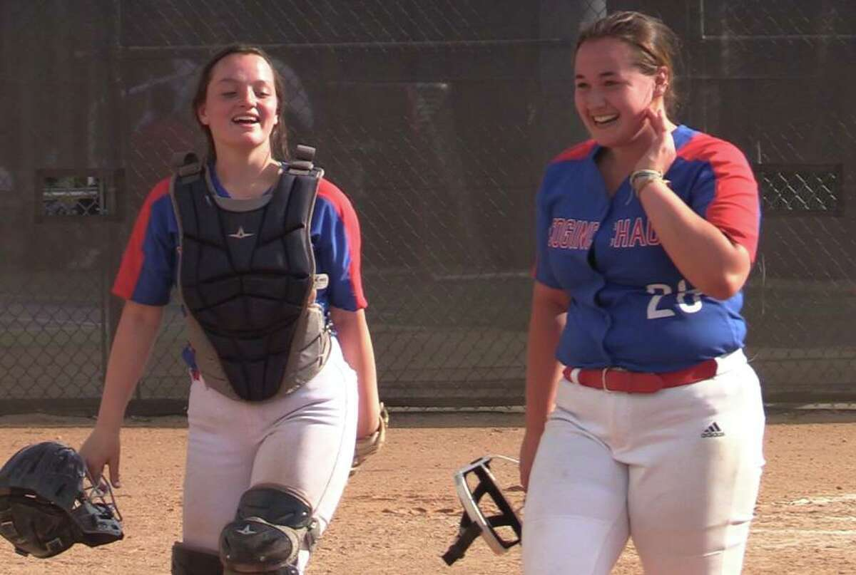 Coginchaug pitcher Kelly Boothroyd (26) and catcher Dana Boothroyd (10) after the Blue Devils' win over North Branford on Tuesday.