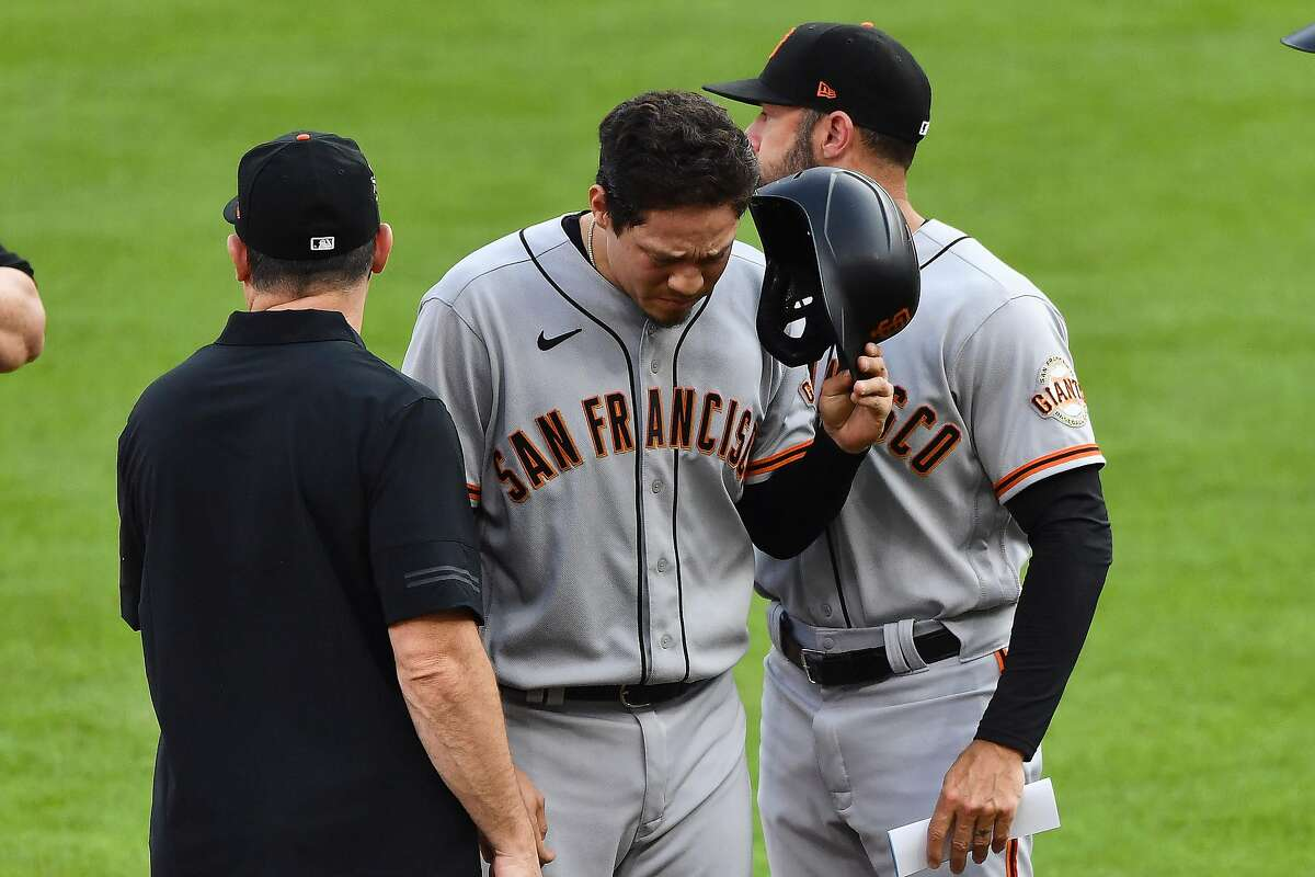 CINCINNATI, OH - MAY 18: Wilmer Flores #41 of the San Francisco Giants leaves the game after running from first base to third base in the second inning against the Cincinnati Reds at Great American Ball Park on May 18, 2021 in Cincinnati, Ohio. (Photo by Jamie Sabau/Getty Images)