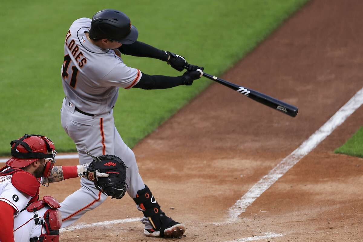 San Francisco Giants' Wilmer Flores bats during a baseball game against the Cincinnati Reds in Cincinnati, Monday, May 17, 2021. The Giants won 6-3. (AP Photo/Aaron Doster)