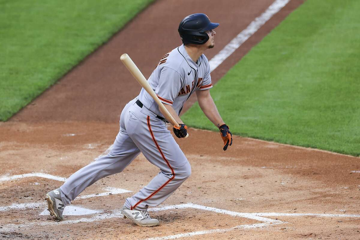 San Francisco Giants' Alex Dickerson watches as he hits a three-run home during the fourth inning of a baseball game against the Cincinnati Reds in Cincinnati, Tuesday, May 18, 2021. (AP Photo/Aaron Doster)