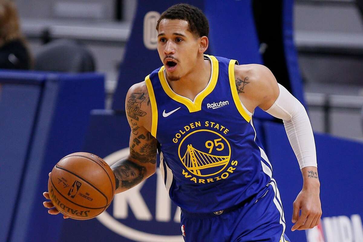 Golden State Warriors forward Juan Toscano-Anderson (95) takes the ball half court in the first quarter of an NBA game against the New Orleans Pelicans at Chase Center, Friday, May 14, 2021, in San Francisco, Calif.