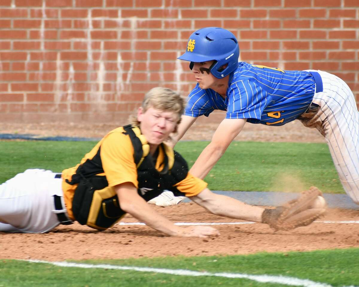 Nazareth's Tanner Birkenfeld slides past Kress catcher Colton Scott as Scott tries to prevent the run during their Region 1-1A semifinal baseball game on Tuesday at Bulldog Park in Plainview.