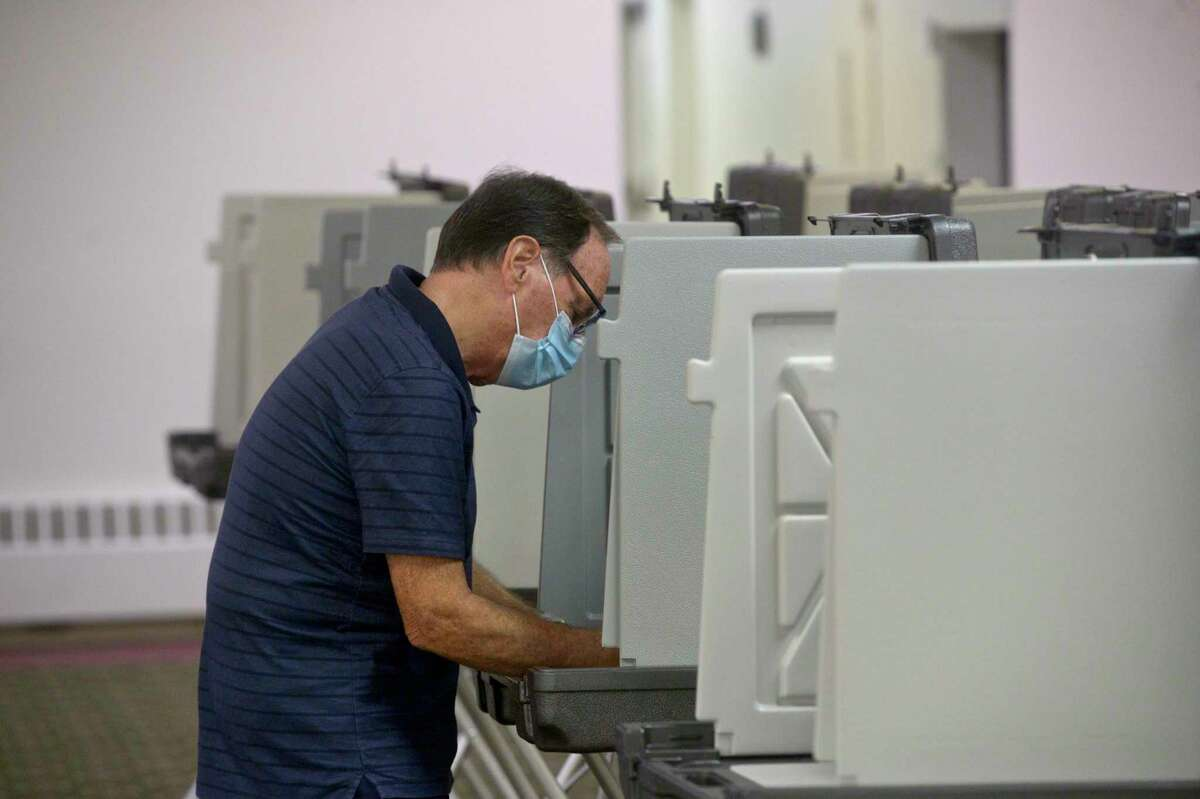 Rudy Guglieri, of Brookfield, voting in the Brookfield budget referendum at St Marguerite Bourgeoys Church. The church was used for voting because Huckleberry Hill Elementary School is under construction. Tuesday, May 18, 2021, in Brookfield, Conn.
