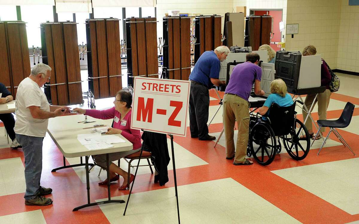 New Milford residents vote on the budget referendum Tuesday at Northville Elementary School, May 15, 2018.