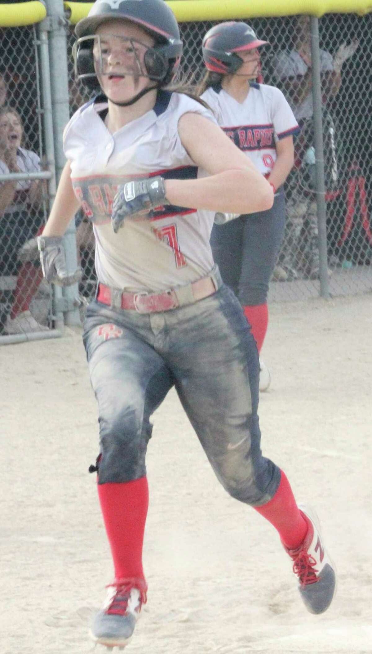 Pharis Carroll crosses the plate for Big Rapids against Newaygo on Tuesday in game two. (Pioneer photo/John Raffel)