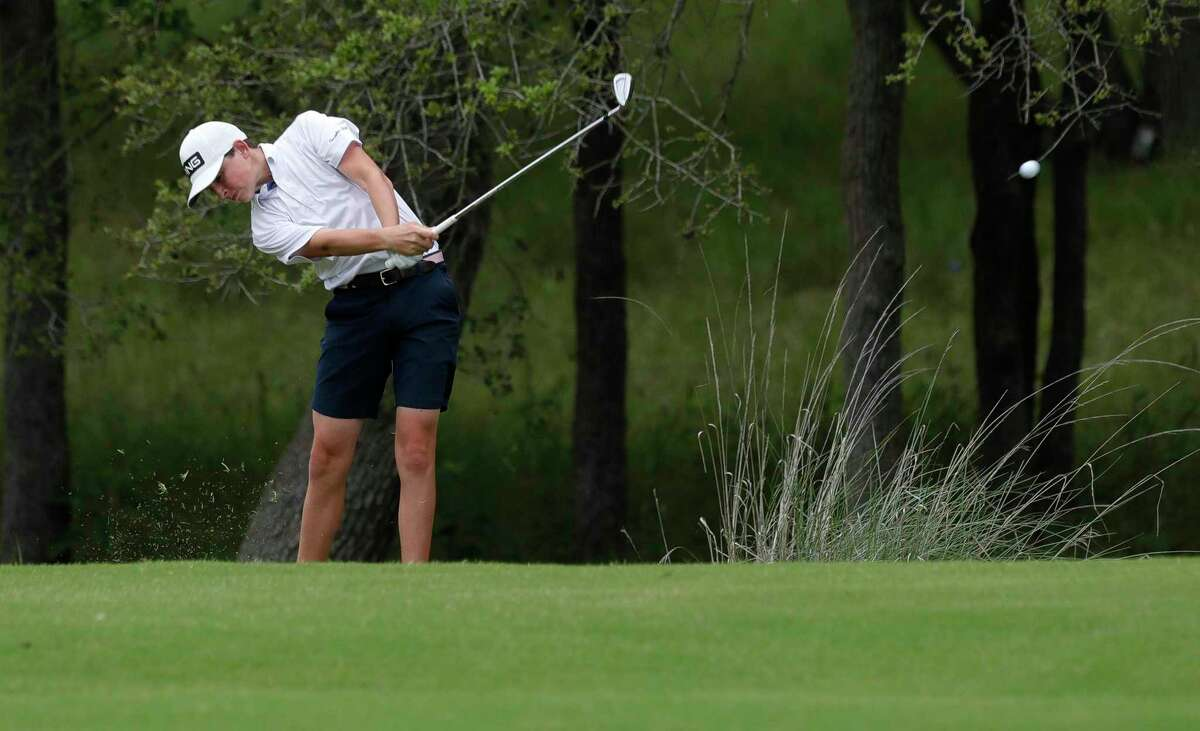 Bowen Ballis of College Park hits his second shot from the rough toward the 9th green during the Class 6A UIL State Golf Championship at Legacy Hills Golf Club, Tuesday, May 18, 2021, in Georgetown.