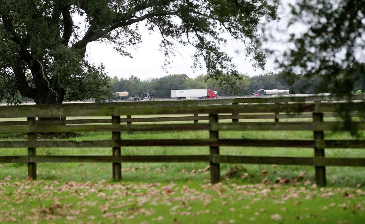 Trucks from I-10 can be seen from Richie DeVillier's backyard of his home that used to be his grandparent's house in Winnie, Texas on Monday, Sept. 21, 2020. The two were flooded out of their home after Harvey and Imelda.