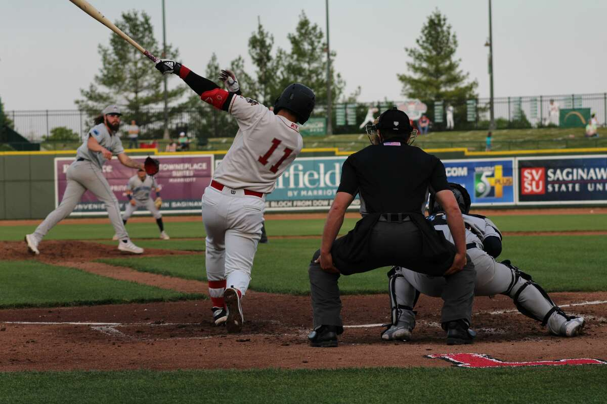 Loons third baseman Miguel Vargas swings at a pitch against Lake County on May 18 at Dow Diamond.