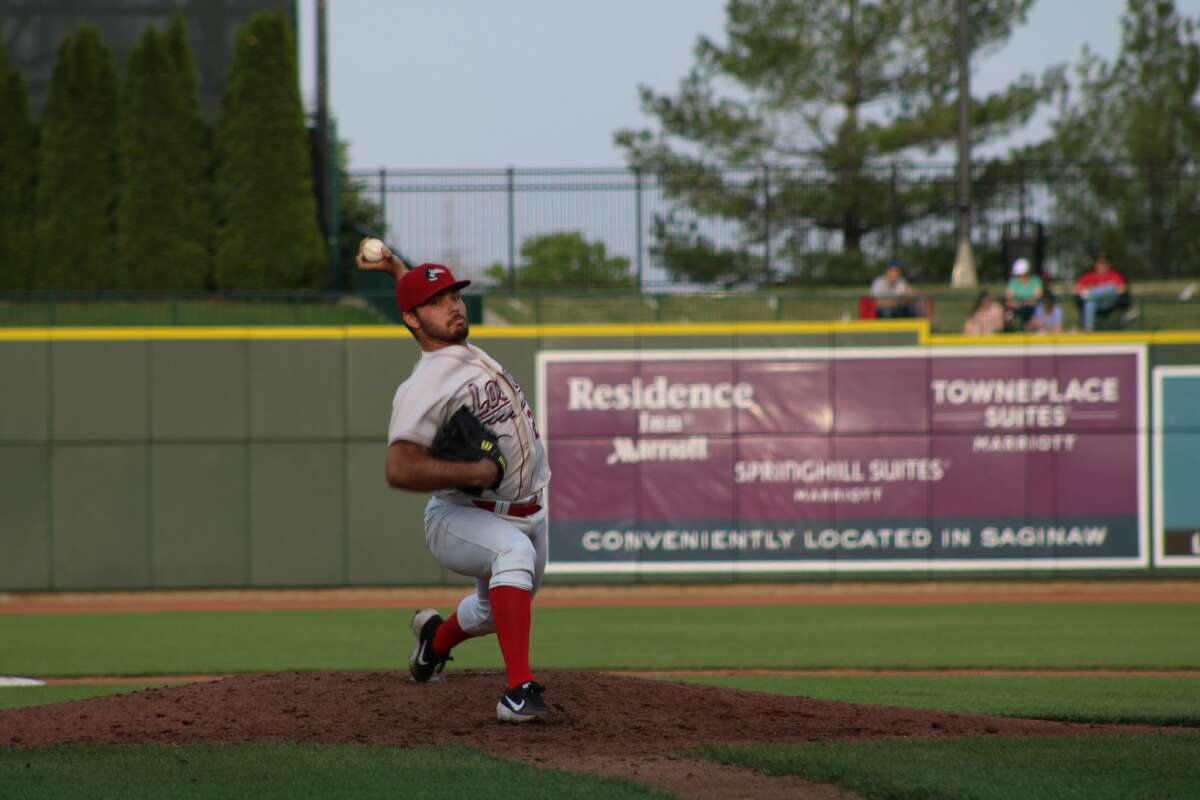 Loons starting pitcher Alec Gamboa winds up to pitch against Lake County on May 18, 2021 at Dow Diamond.