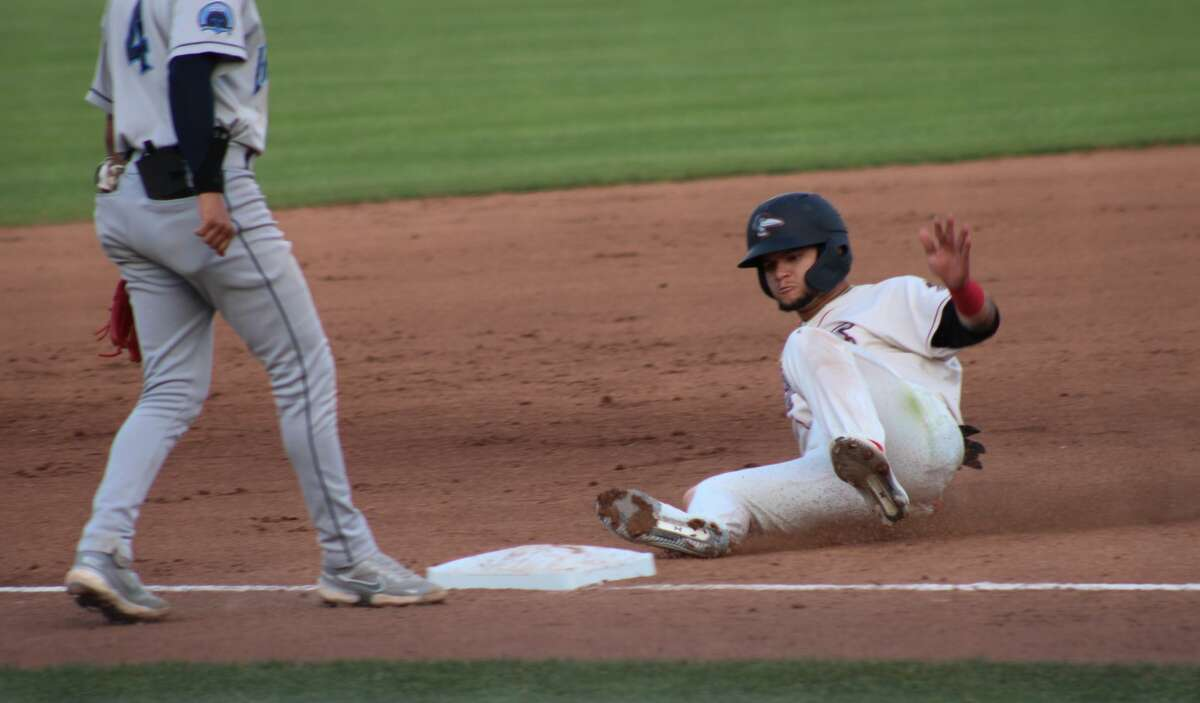 Loons right fielder Andy Pages slides into third base during a May 18, 2021 game against Lake County at Dow Diamond.