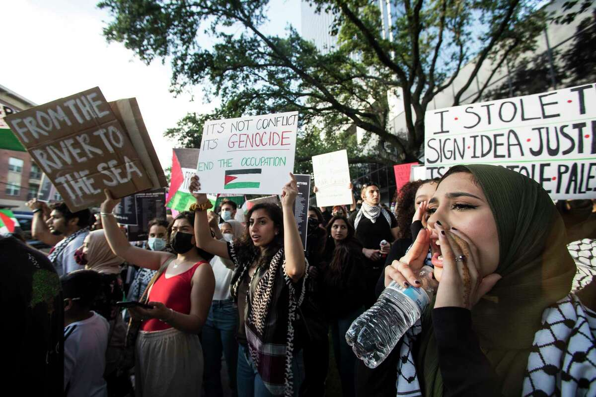 """Supporters of Palestine demonstrate near the intersection of Weslayan and the Southwest Freeway, near the Israeli consulate, as they show their support to the Palestinian resistance to the ongoing violence in the Middle East Tuesday, May 18, 2021 in Houston. Hundreds of protestors chanted slogans of """"Free, free Palestine. From the river to the sea, Palestine will be free"""" throughout the demonstration."""