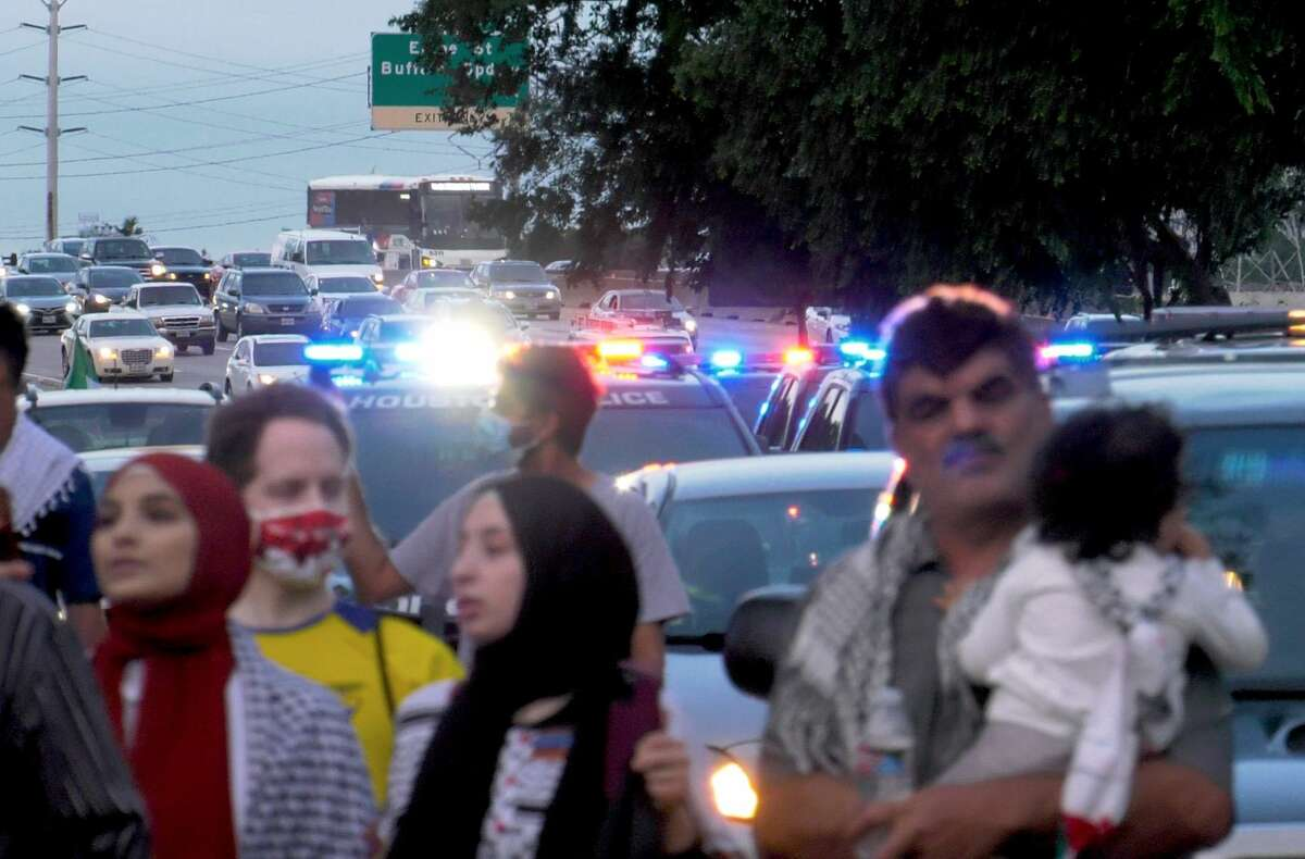 Houston Police trail marchers during a peaceful Free Palestine demonstration on Tuesday, May 18, 2021 in Houston.