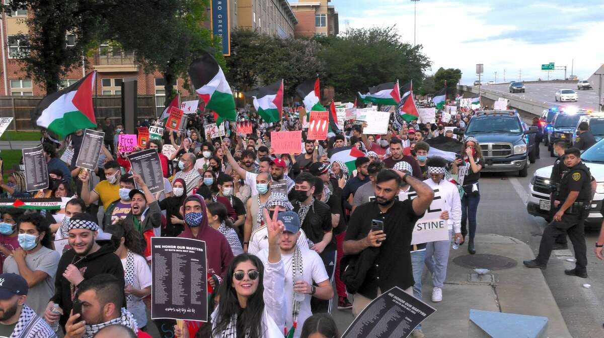 Free Palestine demonstrators march down the U.S. 59 frontage road in Houston on Tuesday, May 18, 2021.
