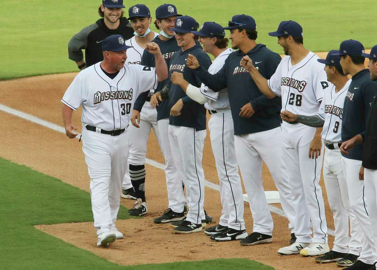 San Antonio Missions manager Phillip Wellman (30) greets his players before they play their season home opener against the Frisco Rough Riders at Wolff Stadium on Tuesday, May 18, 2021. Frisco defeated the Missions, 1-0.