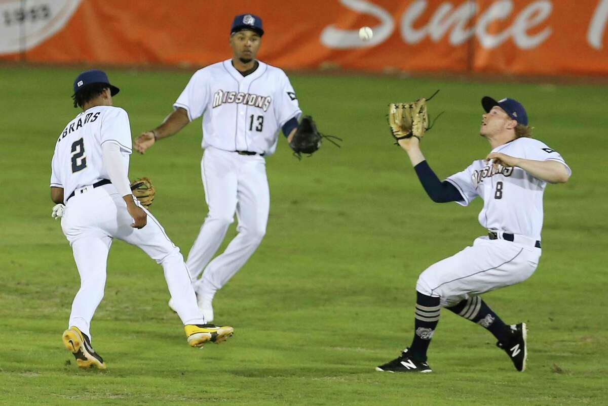 Missions outfielder Jack Suwinski (8) makes a catch for an out beside teammates CJ Abrams (2) and Jose Azocar (13) during their season home opener against the Frisco RoughRiders at Wolff Stadium on Tuesday, May 18, 2021. Frisco defeated the Missions 1-0.