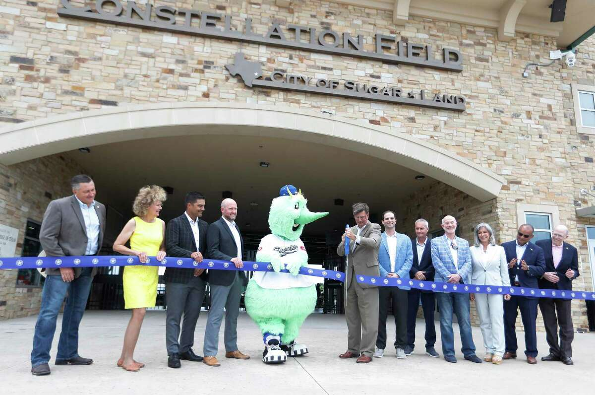 """""""Swatson"""" the Sugar Land Skeeters' mascot helps Sugar Land Mayor Joe Zimmerman cut the ribbon along with members of the city council and Astros GM James Click during the Skeeters' 2021 Media Day at Constellation Field, Tuesday, May 18, 2021, in Sugar Land. The Skeeters have become the new Astros Triple A affiliate."""