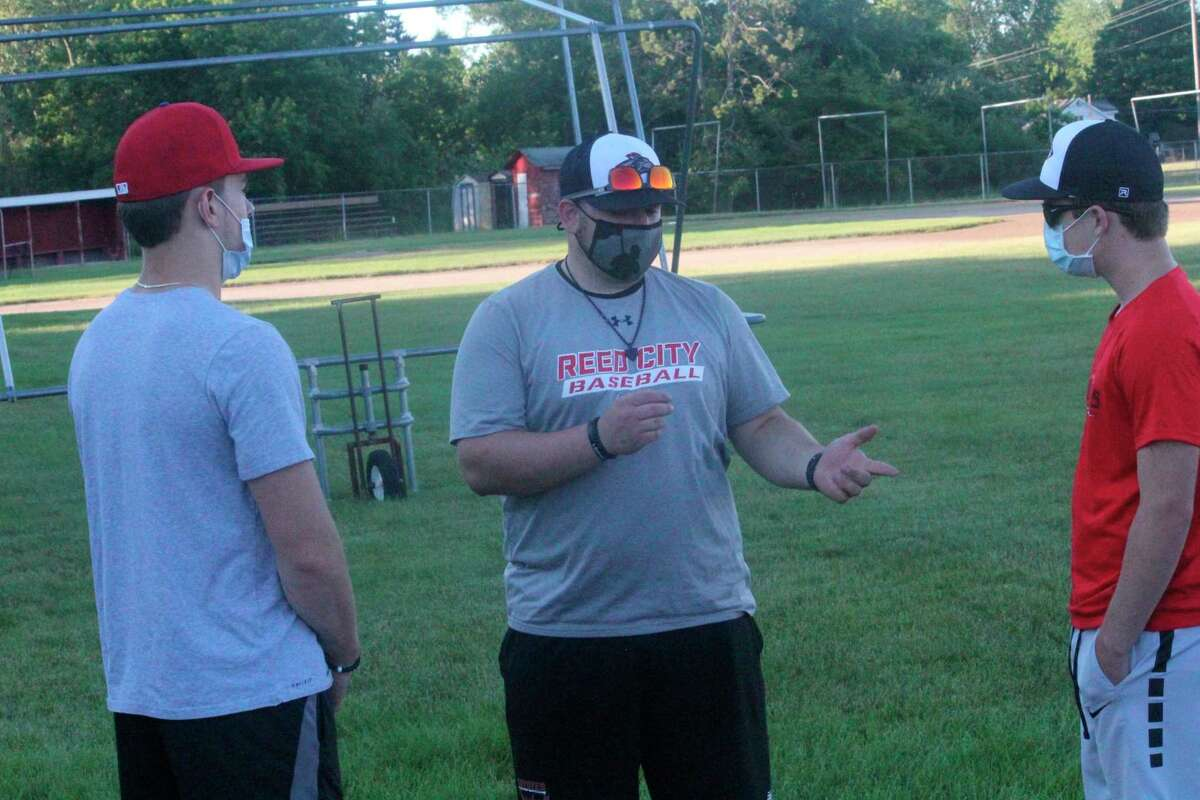 Reed City baseball coach Eric Grannis (center) and his team hopes for a strong finish to the season. (Herald Review file photo)