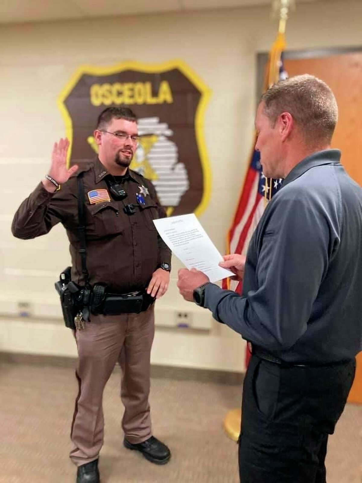 Deputy Ryan Douglas (left) was recently sworn in as the newest member of the Osceola County Sheriff's Office. (Submitted photo)