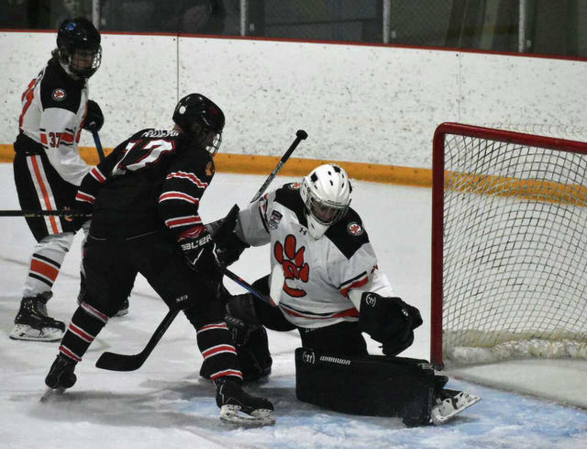 Edwardsville goalie Jonas Akeman makes a skate save on a rebound attempt by Granite City's Mason Roehr in the second period of Game 1 of the MVHCA championship on Tuesday inside the East Alton Ice Arena.