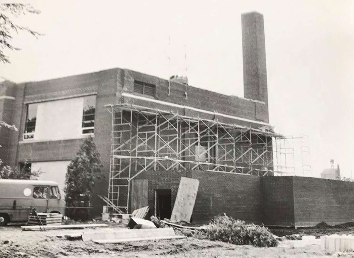 A section of the State Street School, built in 1918 or 1919, was razed as part of a renovation and closed in with bricks. The school will service the new administration building being built nearby with all its necessary utilities. August 1969