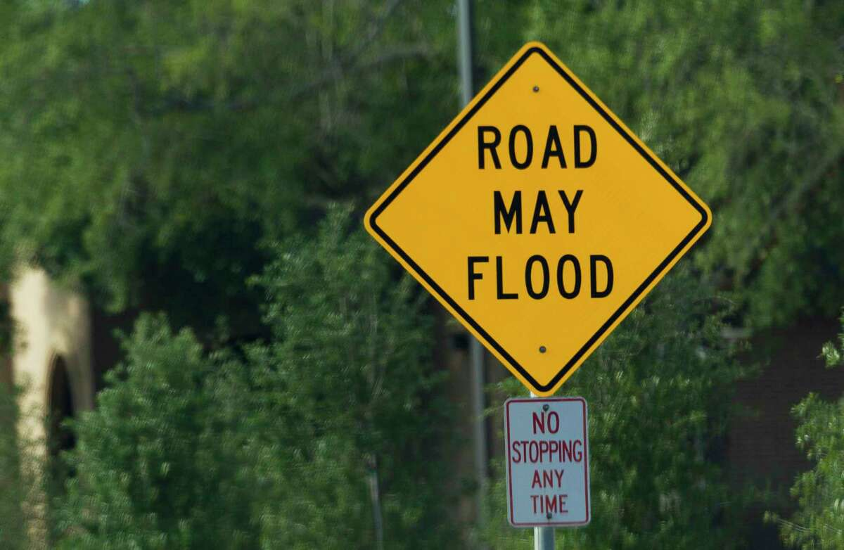 A sign warns motorist of the potential of flooding along a portion of North Frazier Street near McDade Street, an area known for flooding in heavy rain in Conroe. After monitoring overnight severe thunderstorms, school districts in Montgomery County remained open for school Wednesday.