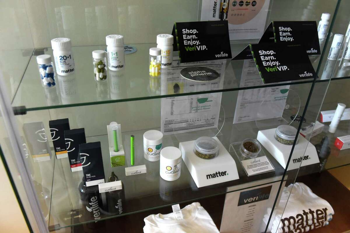 Medical cannabis products are displayed in the waiting area of the Verilife dispensary on Tuesday, May 18, 2021, in Guilderland, N.Y. Modifications to medical cannabis rules which were passed alongside adult-use legalization in March have been slow rollout. (Will Waldron/Times Union)