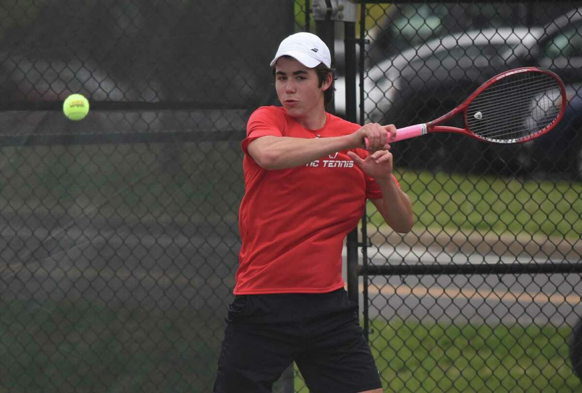 New Canaan's Ben Graham hits a forehand shot during a boys tennis match against Norwalk in New Canaan on Monday, May 10.