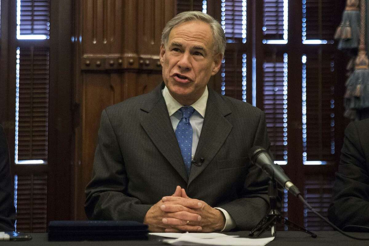 Gov. Greg Abbott signs into law Senate Bill 11, aimed at strengthening school safety, at the Capitol on June 6. (LOLA GOMEZ/AMERICAN-STATESMAN/TNS)