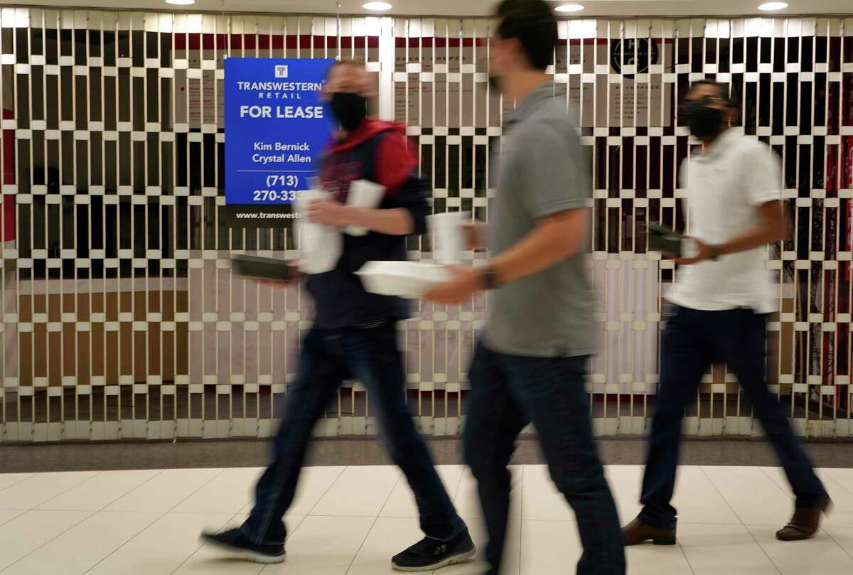 People walk on the tunnel level at the food court in One Allen Center, 500 Dallas St. in Houston. Business is starting to pick up downtown as offices begin a gradual return to in-person work. Some restaurants and stores in the tunnels shuttered permanently amid the COVID-19 pandemic.