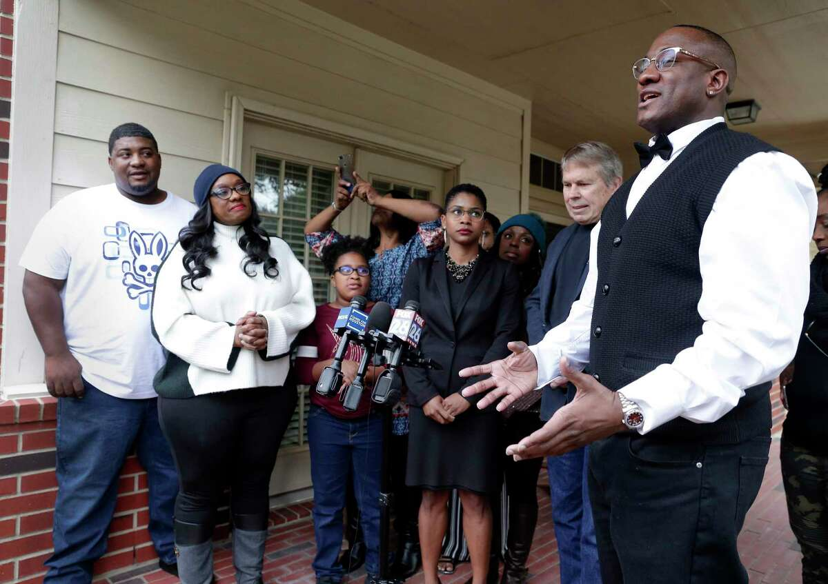 Lydell Grant, far right, surrounded by family and his legal team, speaks about his release and pending exoneration for the murder of AaronScheerhoornduring a press conference on the front porch of his family's Bear Creek home Saturday, Dec. 21, 2019 in Houston, TX.