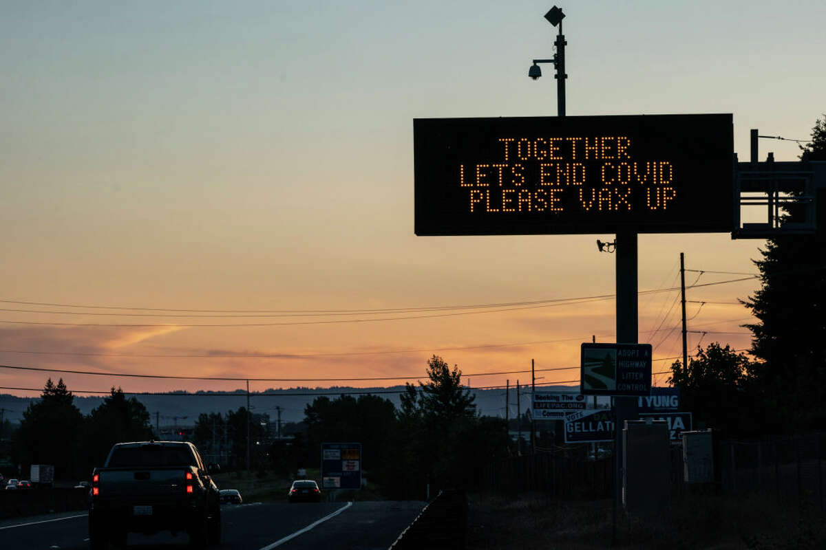 A digital highway sign promotes COVID-19 vaccination on May 14, 2021 in Vancouver, Washington. Gov. Jay Inslee announced Thursday that the state-wide mask mandate would no longer apply to fully vaccinated adults.