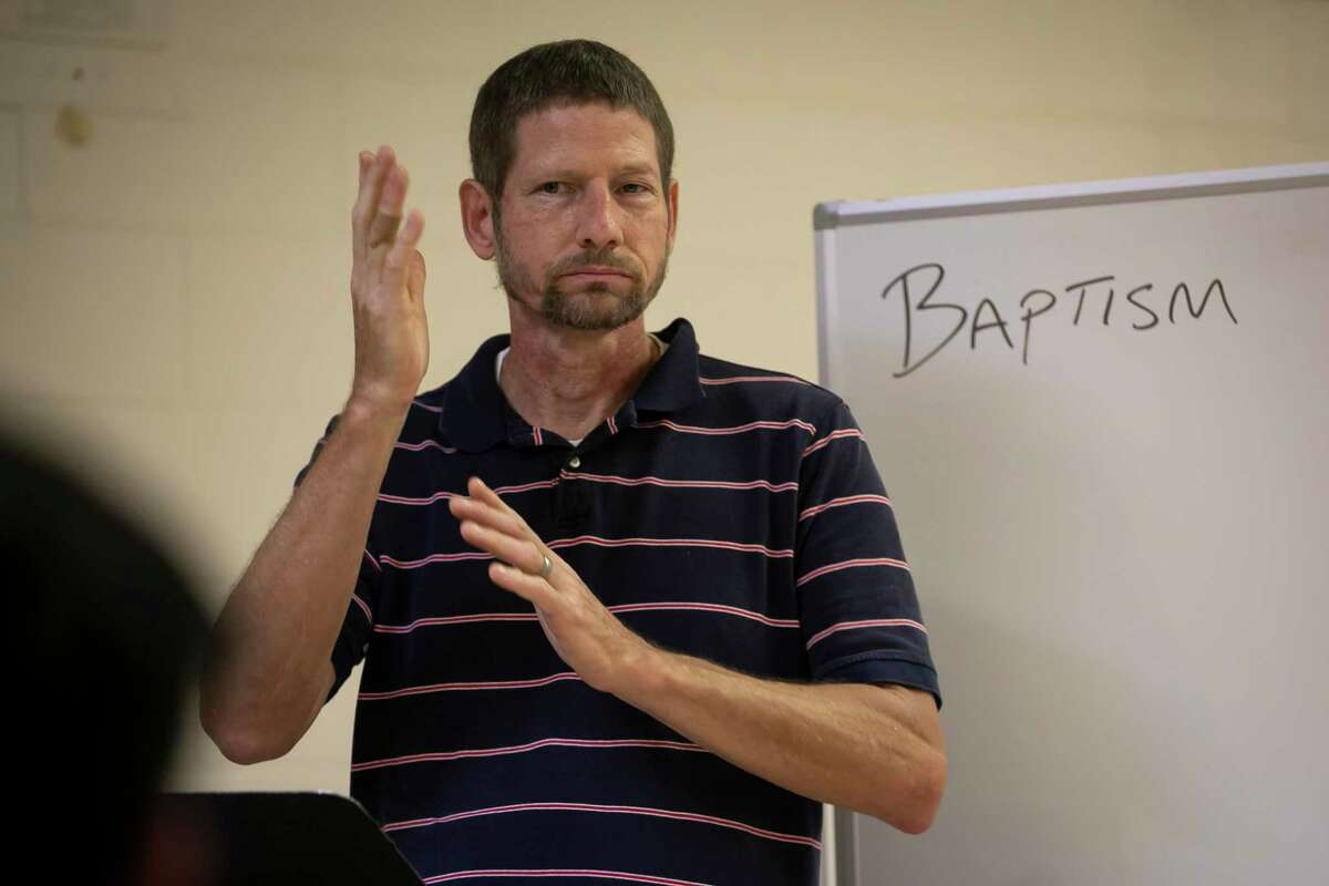 Deacon Bruce Flagg teaches during a baptism class for family members at Holy Ghost Church's Community Center on Saturday, May 8, 2021. Flagg, who is Deaf, led the class for three Deaf siblings before their niece's baptism.