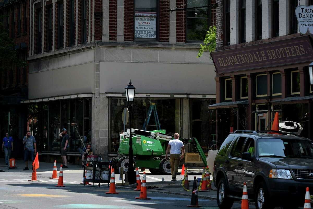 Storefronts in Troy's Monument Square are being transformed into a victorian era street setting for the filming of