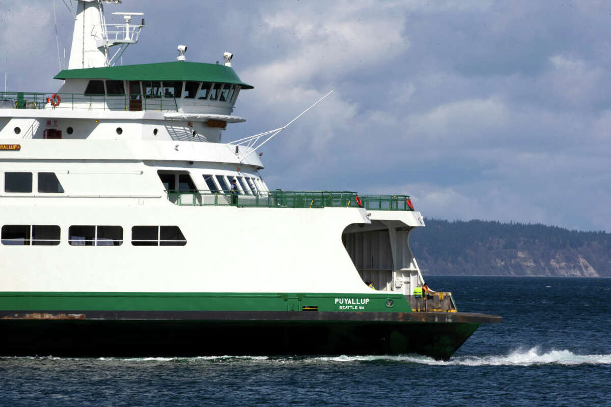 A Washington State ferry pulls up to the dock on March 29, 2020 in Edmonds, Washington.