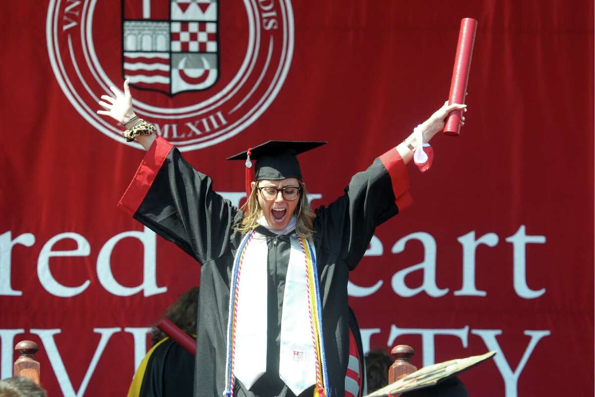 Angelica Piegari celebrates after receiving her diploma during commencement for the Sacred Heart University Class of 2021, in Fairfield, Conn. May 19, 2021.